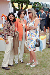 Left to right, MAHNAZ MALIK, BIANCA JAGGER and SABRINA GUINNESS at the Veuve Clicquot Gold Cup polo final held at Cowdray Park, Midhurst, West Sussex on 18th July 2010.