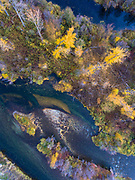 Aerial photo of the mouth of the Entiat River with drifting leaves and fall colors.