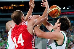 Edo Muric of Slovenia, Luka Zoric of Croatia and Matjaz Smodis of Slovenia in battle for ball at friendly match between Slovenia and Croatia for Adecco Cup 2011 as part of exhibition games before European Championship Lithuania on August 8, 2011, in SRC Stozice, Ljubljana, Slovenia. (Photo by Matic Klansek Velej / Sportida)