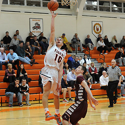 TOM KELLY IV &mdash; DAILY TIMES<br /> Marple Newtown's Nick Giordano (10) goes up for a layup past Garnet Valley's Danny Guy (11) during the Garnet Valley at Marple Newtown boys basketball game on Tuesday night December 9, 2014.