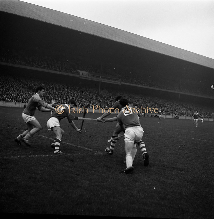 13/11/1966<br /> 11/13/1966<br /> 13 November 1966<br /> Under 21 Hurling Final: Cork v Wexford at Croke Park, Dublin.<br /> Cork full-forward, A. Flynn (second from the right) pulls on a ball on the ground, with M. Nolan (Wexford 3) on the right and C. McCarthy (Cork 13). (Wexford's A. Somers is also in the picture)