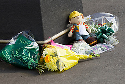 © Licensed to London News Pictures. 27/06/2012. Oldham , UK . A large explosion , believed to be caused by gas , has brought down at least one house in an Oldham terrace. A makeshift shrine dedicated to 2 year old Jamie Heaton who was killed in the blast . Photo credit : Joel Goodman/LNP