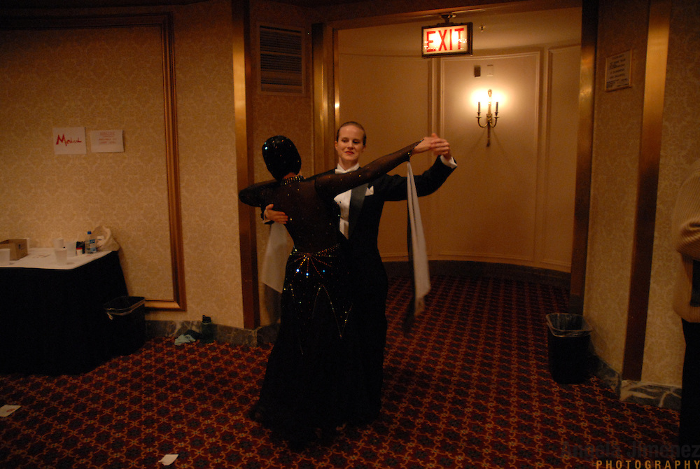 ****EMBARGO: NOT FOR PUBLICATION IN THE ADVOCATE, CURVE, GONYC OR OUT MAGAZINES..Lesbian ballroom dancers Zoe Balfour, left, and Citabria Phillips, both of Oakland, California, warm up before they compete during the Dancesport ballroom dancing competition at the Hilton Hotel and Towers in downtown Chicago during Gay Games VII on July 20, 2006. ..Over 12,000 gay and lesbian athletes from 60 countries are in Chicago competing in 30 sports during the Games from July 15 through 22, 2006. ..Over 50,000 athletes have competed in the quadrennial Games since they were founded by Dr. Tom Wadell, a 1968 Olympic decathlete, and a group of friends in San Francisco in 1982, with the goal of using athletics to promote community building and social change. ..The Gay Games resemble the Olympics in structure, but the spirit is one of inclusion, rather than exclusivity. There are no qualifying events or minimum or maximum requirements...The Games have been held in Vancouver (1990), New York (1994), Amsterdam (1998), and Sydney (2002). .