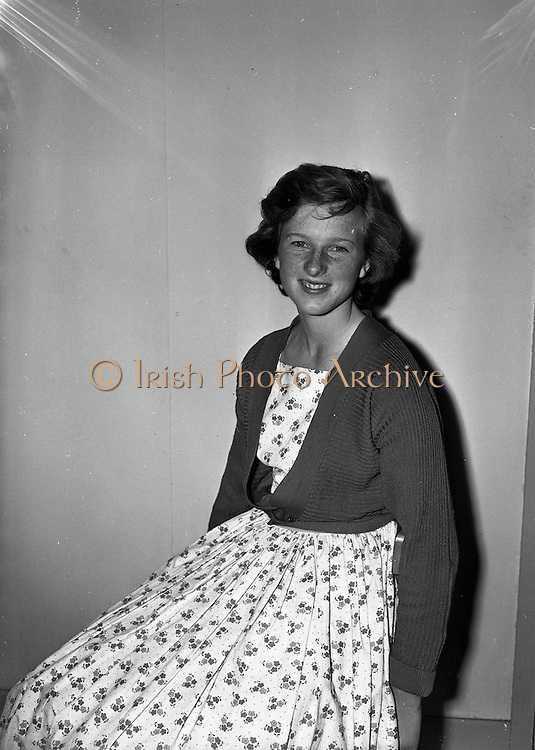 7/8/1958<br /> 8/7/1958<br /> 07 August 1958<br /> <br /> Miss Suzanne at Findlater taking her passport photo