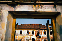 Fort Kochi, India -- February 12, 2018: The skeletal remains of an old spice warehouse along the waterfront.