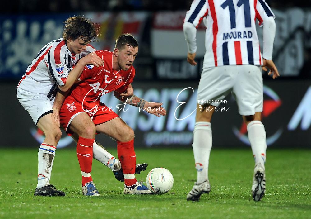 14-03-2009 Voetbal:Willem II:FC Twente:Tilburg<br /> Niels VORTHOREN (L) verdedigt Theo JANSSEN (R)<br /> Foto: Geert van Erven