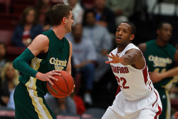 Nov 15, 2011; Stanford CA, USA;  Colorado State Rams guard Wes Eikmeier (left) is defended by Stanford Cardinal guard Jarrett Mann (22) during the first half of a preseason NIT game at Maples Pavilion. Mandatory Credit: Jason O. Watson-US PRESSWIRE