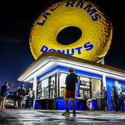 LA Rams fans come to Randys Donuts in Los Angeles,CA off of Manchester blvd.  and the 405 freeway to celebrate the LA Rams football team making it into the superbowl.