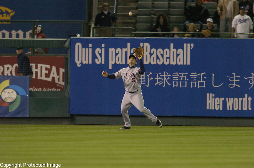 Team USA's Matt Holliday makes a catch in left field off the bat of Jong Beom Lee in the 2nd inning against Team Korea in Round 2 action at Angel Stadium of Anaheim.
