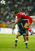 Photograph: Scott Heavey.<br />Ajax Amsterdam v Liverpool. Amsterdam Cup at The Amsterdam ArenA. 01/08/2003.<br />Gregory Vignal uses every tactic to tackle Steven Pienaar.