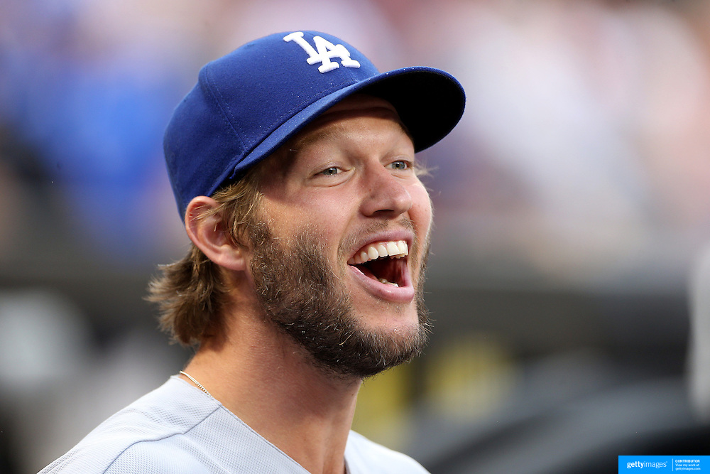 NEW YORK, NEW YORK - May 22:  Clayton Kershaw #22 of the Los Angeles Dodgers sharing a joke with team mates in the dugout before the Los Angeles Dodgers Vs New York Mets regular season MLB game at Citi Field on May 27, 2016 in New York City. (Photo by Tim Clayton/Corbis via Getty Images)