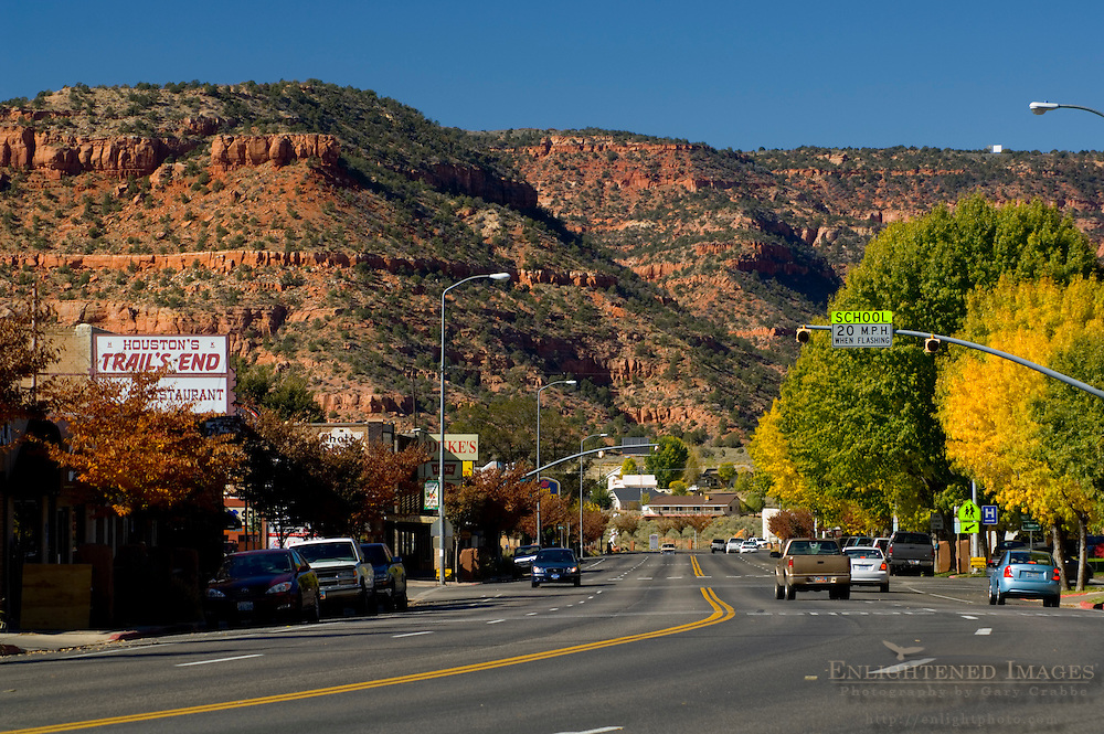 Red rock butte over traffic in downtown Kanab, Kane County, southern Utah