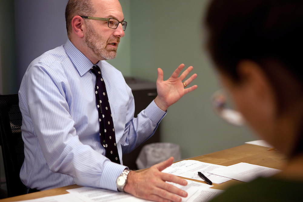 Craig Gurian, left, an attorney from The Anti-Discrimination Center who brought a fair housing lawsuit against Westchester County, works with colleague Heather Rogers, right, during a meeting in his office in New York, NY on October 23, 2012.