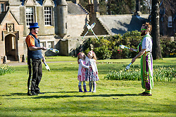Pictured: Rob Thorburn (hat) and Will Borrell entertained Lily Donald (4 and floral hairband) and Isla Sutherland (4 bow headband) with their juggling skills.<br /> <br /> The Festival of Museums launch featured performers, Rob Thorburn (hat), Will Borrell, Alyssa Brough (blue jacket) and Kate McWilliam from Circus Alba showcasing their skills.<br /> <br /> Ger Harley | EEm 30 March 2016