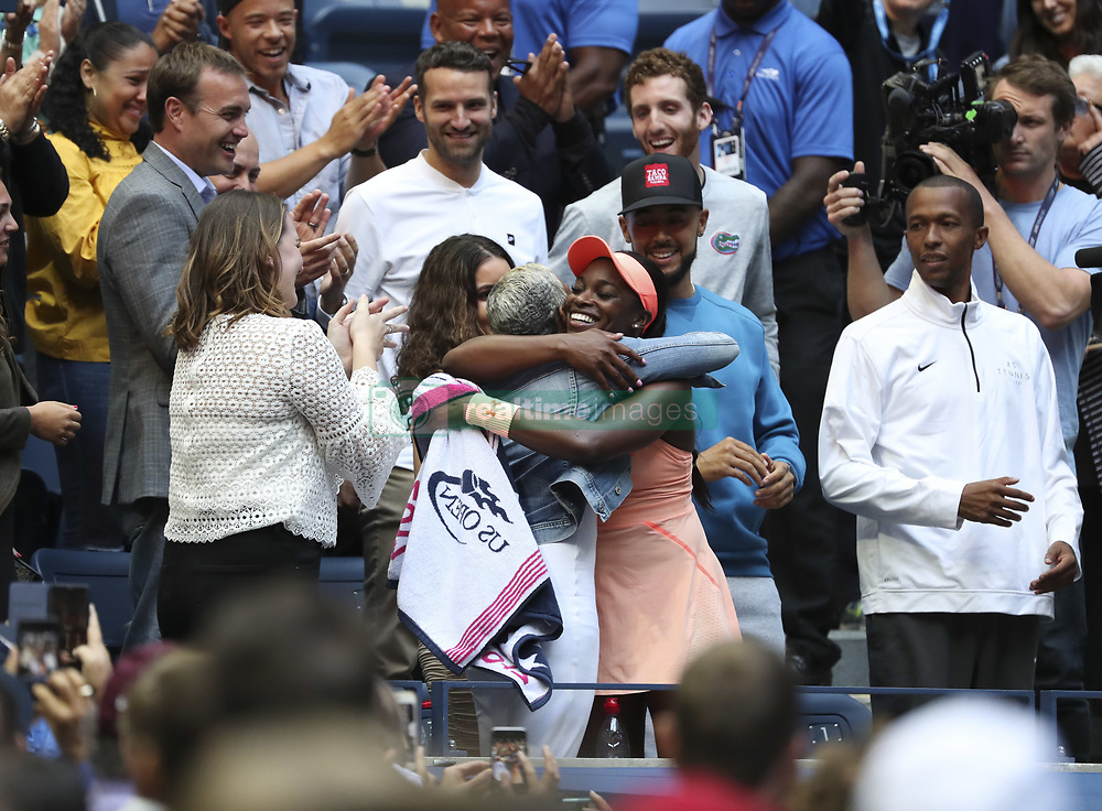 NEW YORK, Sept. 10, 2017  Sloane Stephens (Center, R) of the United States hugs with her mother Sibyl Smith after winning the women's singles final match against Madison Keys of the United States at the 2017 US Open in New York, the United States, Sept. 9, 2017. Sloane Stephens won 2-0 to claim the title. (Credit Image: © Wang Ying/Xinhua via ZUMA Wire)