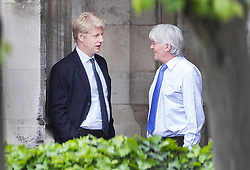 © Licensed to London News Pictures. 07/05/2019. London, UK. Conservative MPs Jo Johnson (L) and Andrew Mitchell talk together in Parliament. High level cross party talks have started today in an attempt to reach a compromise over Brexit. Photo credit: Peter Macdiarmid/LNP