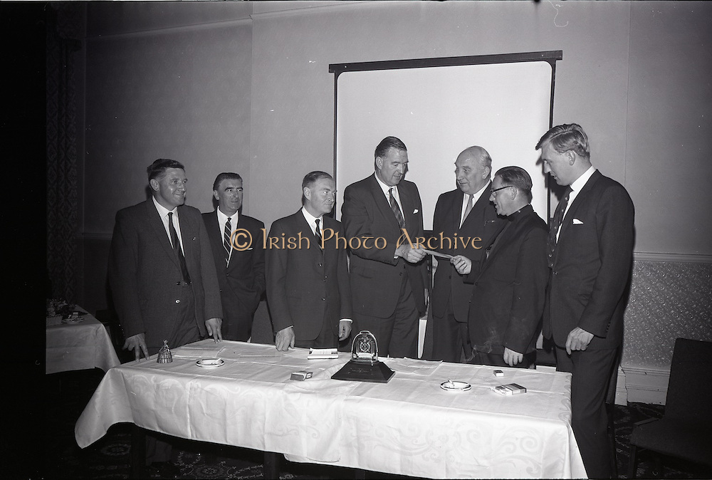 28/06/1965<br /> 06/28/1965<br /> 28 June 1965<br /> Reception for presentation of funding by W.D. & H.O., Wills to Glenageary Horse Show Committee at the Royal Marine Hotel, Dun Laoghaire, Dublin. Image shows Mr. D.R. Mott, Managing Director of W.D. & H.O. Wills (Ireland) handing over a cheque for the sponsorship by Wills, of the Glenageary Horse Show to Rev. Fr. R. O'Donoghue C.C., Glenageary. Also in the picture are (l-r): Mr. P.T. Fining, P.R.O. Horse Show Committee; Mr. W.J. Kennedy, Secretary Horse Show; Mr. Liam Cosgrove T.D.; Mr. D. Bloomer, Chairman, Horse Show Committee and Mr. David Andrews T.D..