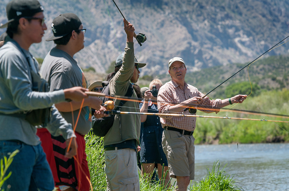 em072117a/a/Sen. Tom Udall, right, fishes with Frank Pacheco, 18, second from right, and others from Kewa Pueblo, on the Rio Grande in the Orilla Verde Recreation Area near Pilar, Friday, July 21, 2017. Sen. Udall was there to hear from community members about the economic and recreational benefits of the Rio Grande del Norte National Monument. (Eddie Moore/Albuquerque Journal)