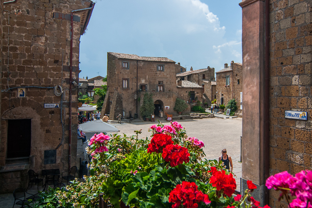 A view of San Donato square in the village of Civita di Bagnoregio.<br /> Civita di Bagnoregio is a town in the Province of Viterbo in central Italy, a suburb of the comune of Bagnoregio, 1 kilometre (0.6 mi) east from it. It is about 120 kilometres (75 mi) north of Rome. Civita was founded by Etruscans more than 2,500 years ago. Bagnoregio continues as a small but prosperous town, while Civita became known in Italian as La citt&agrave; che muore (&quot;The Dying Town&quot;). Civita has only recently been experiencing a tourist revival. The population today varies from about 7 people in winter to more than 100 in summer.The town was placed on the World Monuments Fund's 2006 Watch List of the 100 Most Endangered Sites, because of threats it faces from erosion and unregulated tourism.