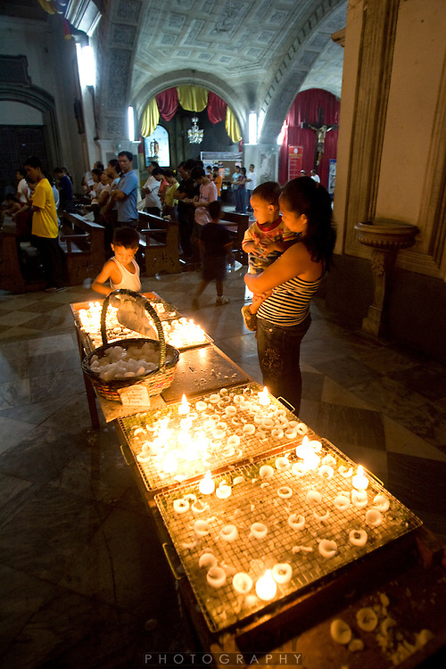 "Votive candles at San Agust?n Church is a Roman Catholic church under the auspices of The Order of St. Augustine, located inside the historic walled city of Intramuros in Manila. Completed by 1607, it is the oldest church currently standing in the Philippines.  No other surviving building in the Philippines has been claimed to pre-date San Agustin Church..In 1993, San Agustin Church was one of four Philippine churches constructed during during the Spanish colonial period designated by the UNESCO as a World Heritage Site, under the classification ""Baroque Churches of the Philippines."" It had been named a National Historical Landmark by the Philippine government in 1976...Photo by Jason Doiy.6-15-08"