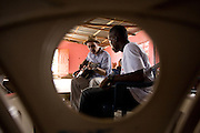Canadian artist Dave Bidini (right) jams with members of the band King's Jubilee, (seen here is Zaroe Amilcar) at the  Buduburam refugee settlement, roughly 20 km west of Ghana's capital Accra on Friday April 13, 2007. The group, which is composed of five Liberian men living at Buduburam, is currently recording their second album, and already has a growing number of fans back in Liberia. The Buduburam refugee settlement is still home over 30,000 Liberians, most of which have mixed feelings about returning to Liberia..