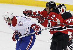 Jan 22, 2010; Newark, NJ, USA; New Jersey Devils defenseman Mark Fraser (2) hits Montreal Canadiens left wing Benoit Pouliot (57)  during the first period at the Prudential Center.