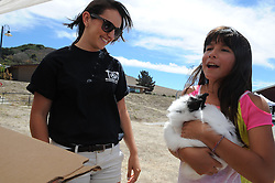 Emily Ramirez, 11, handles an angora rabbit at Sunday's Rancho Cielo Family Fun Day in Salinas.