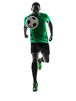 one african man soccer player green jersey running with football in silhouette on white background
