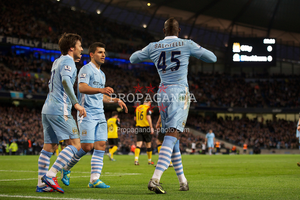 MANCHESTER, ENGLAND - Saturday, February 25, 2012: Manchester City's Mario Balotelli celebrates scoring the first goal against Blackburn Rovers during the Premiership match at City of Manchester Stadium. (Pic by David Rawcliffe/Propaganda)