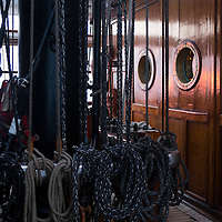 Rigging tied up under a mast on the Sea Cloud sailing yacht while on the Mediterranean Sea.