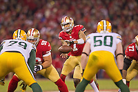 12 January 2013: Quarterback (7) Colin Kaepernick of the San Francisco 49ers receives at the snap against the Green Bay Packers during the first half of the 49ers 45-31 victory over the Packers in an NFL Divisional Playoff Game at Candlestick Park in San Francisco, CA.