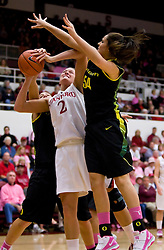 February 18, 2010; Stanford, CA, USA; Stanford Cardinal forward/center Jayne Appel (2) is fouled by Oregon Ducks forward/center Nicole Canepa (54) during the first half at Maples Pavilion.  Stanford defeated Oregon 104-60.