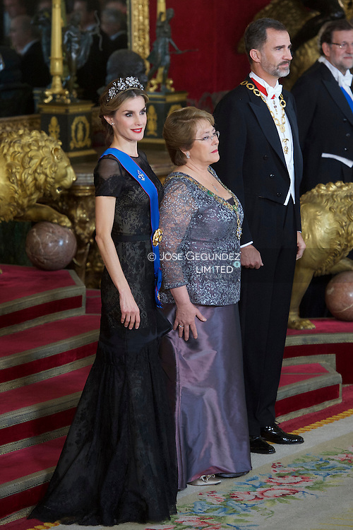 King Felipe VI of Spain, Queen Letizia of Spain and MIchelle Bachelet attended a Gala Dinner in honour of Chilean President during her State Visit at Palacio Real on October 29, 2014 in Madrid