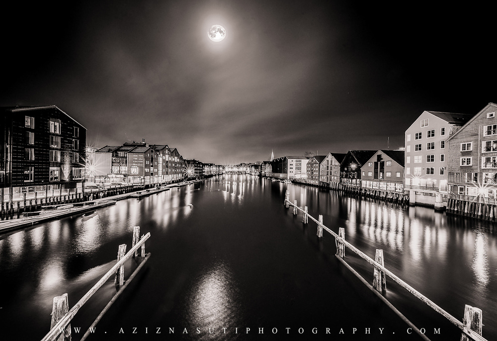 This picture has been taken at 1:30 am in a very cold but beautiful night in Trondheim. A supermoon is the coincidence of a full moon or a New moon with the closest approach the Moon makes to the Earth on its elliptical orbit, resulting in the largest apparent size of the lunar disk as seen from Earth. This picture has been taken in the morning so it is lose to 98% of the moon. Please feel free to check my photos here or find me by: |Website| ,