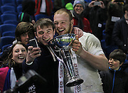 England's Charlie Beckett (Leicester Tigers) with the winning trophy during the Under 20s Six Nations Championship match between England and France at the American Express Community Stadium, Brighton and Hove, England on 20 March 2015. Photo by Phil Duncan.