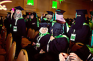 Samar Almadani of Jeddah, Saudi Arabia speaks with another Saudi National and recent masters degree recipient during the Royal Embassy of Saudi Arabia Cultural Mission's Graduation Ceremony at the Gaylord Hotel, National Harbor, MD.  The graduation ceremony is part of the higher education program initiated in the wake of September 11th to improve relations between the U.S. and Saudi Arabia as well as train the nation's next generation of leaders.  Despite exposure to Western mores, many of the graduates in attendance expressed a desire to move back to Saudi Arabia and maintain their traditional values.<br />