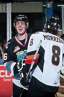 KELOWNA, CANADA - OCTOBER 24: Kole Lind #16 of Kelowna Rockets shares a laugh with Loch Morrison #8 of Calgary Hitmen on October 24, 2015 at Prospera Place in Kelowna, British Columbia, Canada.  (Photo by Marissa Baecker/Shoot the Breeze)  *** Local Caption *** Kole Lind #16;