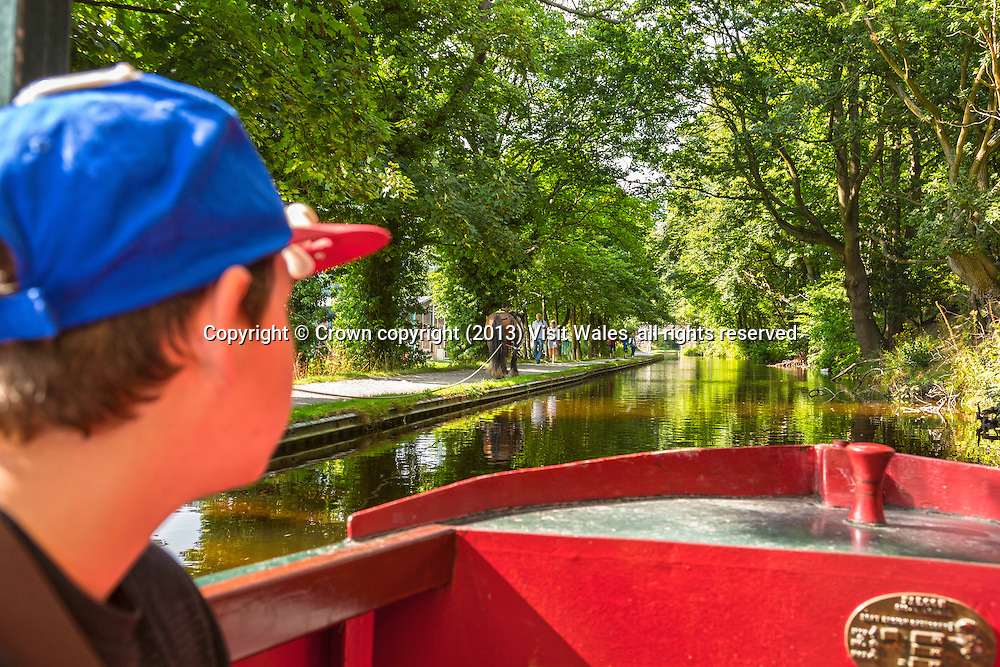 Boy on canal boat trip<br /> Llangollen Canal<br /> Llangollen<br /> Denbighshire<br /> North<br /> Activities<br /> Water<br /> Transport