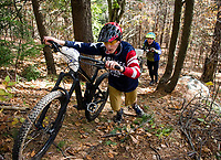 Morgan McCarthy and Kevin McCarthy  head up Cobble Crown trail during the Fall Flurry mountain bike race at Gunstock on Saturday morning.  (Karen Bobotas/for the Laconia Daily Sun)