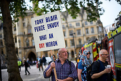 © Licensed to London News Pictures. 06/07/2016. London, UK. Protestors gather in Westminster, central London where the long-awaited Chilcot inquiry into the war in Iraq has been released. Photo credit: Ben Cawthra/LNP