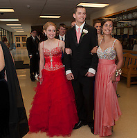 Alexis DuBois, Josh Joyce and Abby Lines lead the Prom March into the Gilford High School gym on Friday evening.   (Karen Bobotas/for the Laconia Daily Sun)