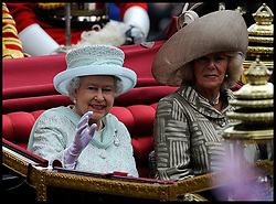 HM The Queen with the Duchess of Cornwall in the Queen's carriage on Whitehall on her way to Buckingham Palace as part of the  Queens Diamond Jubilee, Tuesday June 5, 2012. Photo By Andrew Parsons/i-Images