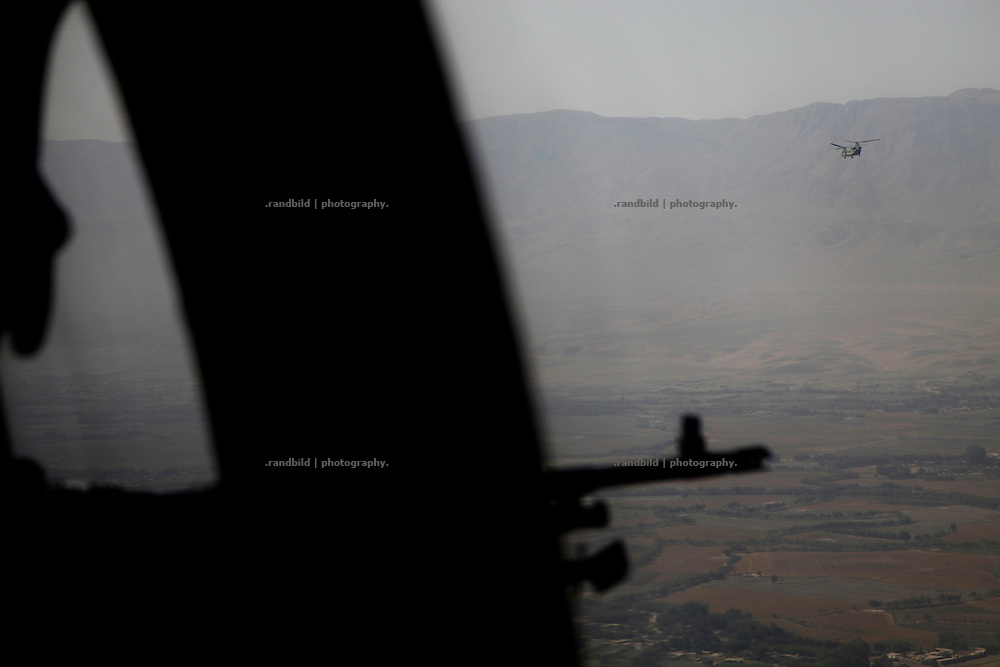 Aerial view down on Northern Afghanistan in the Kunduz/Baghlan area, seen from a US-Black Hawk Helicopter (a the horizon a Chinook Helicopter).