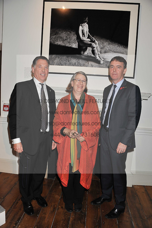 Left to right, DR GLYN DAVIES director of programmes WWF UK, GWYN MILES The Director of Somerset House Trust and JEREMY DARROCH BSkyB chief executive at a private view of AMAZON an exhibition of photographs in aid of 'Sky Rainforest Rescue' held in the East Wing Galleries, Somerset House, London on 1st November 2011.