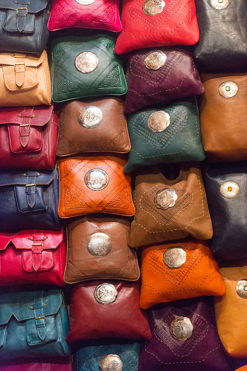 FEZ, MOROCCO - 3rd DECEMBER 2016 - Leather bags hanging for sale in the souks of the old Fez Medina, Middle Atlas Mountains, Morocco.