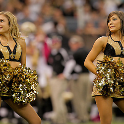 2009 October 04: New Orleans Saints Saintsations cheerleaders perform during 24-10 a win by the New Orleans Saints over the New York Jets at the Louisiana Superdome in New Orleans, Louisiana.