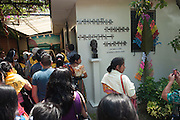 Crowds of pilgrims take souvenir photos with a bronze bust of martyred Archbishop Oscar Romero outside his former rectory and home. El Salvador prepares for the beatification ceremony and mass announcing the beatification of Archbishop Oscar Romero. The Archbishop was slain at the alter of his Church of the Divine Providence by a right wing gunman in 1980. Oscar Arnulfo Romero y Galdamez became the fourth Archbishop of San Salvador, succeeding Luis Chavez, and spoke out against poverty, social injustice, assassinations and torture. Romero was assassinated while offering Mass on March 24, 1980.