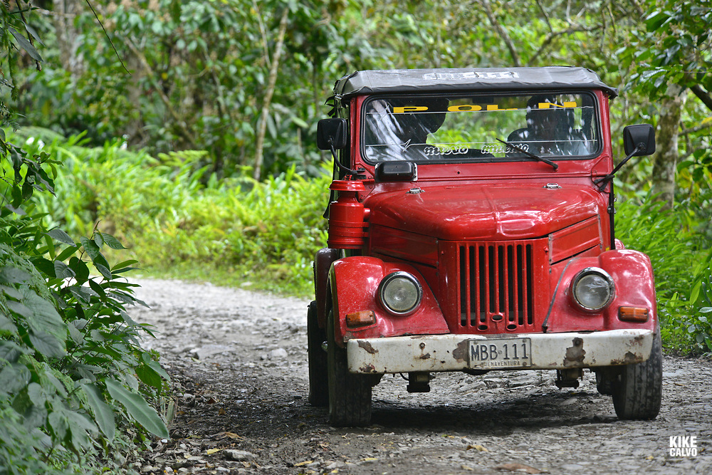 Old car traveling through the old road to Buenaventura near Anchicaya. The location is a humid Forest on the western slope of the West Andes and part of the Chocó Biogeographic Region.