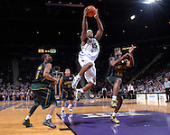 Kansas State forward David Hoskins drives to the basket in the second half, between Baylor defenders Henry Dugat (5) and Kevin Rogers (23) at Bramlage Coliseum in Manhattan, Kansas, January 17, 2007.  K-State beat Baylor 69-60.