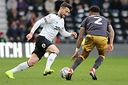 Derby County forward David Nugent runs with the ball as Sheffield Wednesday defender Liam Palmer challenges during the EFL Sky Bet Championship match between Derby County and Sheffield Wednesday at the Pride Park, Derby, England on 9 March 2019.